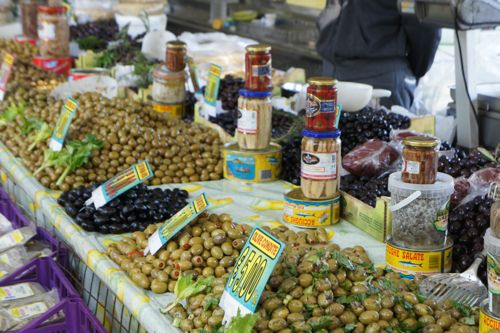 olive table in open air market in Castel di Tusa